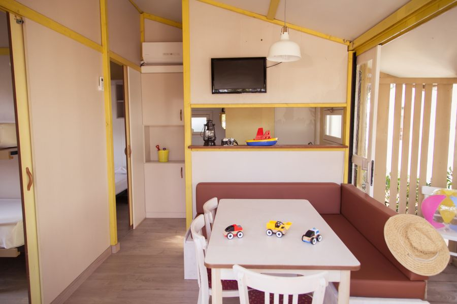 Camping Senia Tucan Family Bungalow for families with children living room and TV